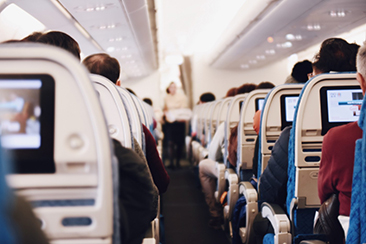 Airplane passengers in their seats – Air Travel and the Pandemic: an Epidemiologist's Perspective